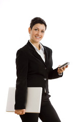 Happy businesswoman with mobile phone and laptop