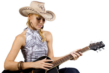Pretty, blonde girl holding guitar, musician in country style.