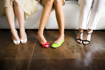 Cropped view of woman wearing mismatched shoes