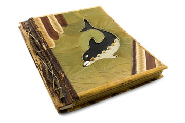 Handmade photo album with dolphin on the cover. Isolated