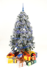 Blue rich christmas tree with amount of christmas presents