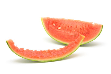 Slice of watermelon and skin in isolated white background
