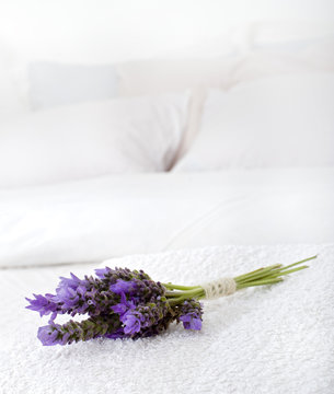 bouquet of lavender on a white towel on a bed