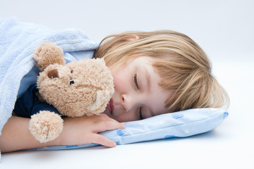 little girl sleeping and hugging her teddy bear