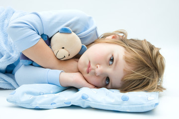 little, sleepless, girl lying in bed with teddy bear