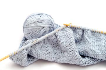 Wool ball and knitting white bamboo needles