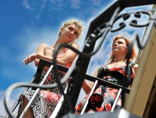 Two beautiful girls on the balcony