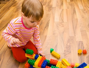 a child plays with toy blocks