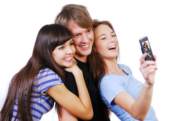 Three beautiful young teenagers taking their self-portrait.