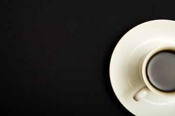 Above view of cup of strong coffee over black background