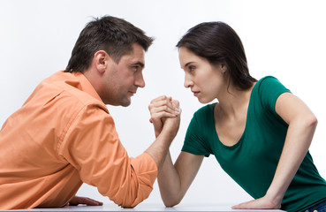 Man and woman doing arm wrestling