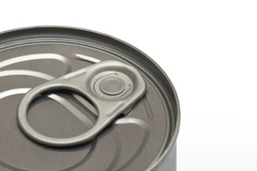 detail of tin can on a white background