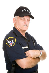 Mature police officer with a suspicious expression.  Isolated