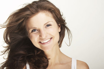 A happy young woman with facial expression on white background
