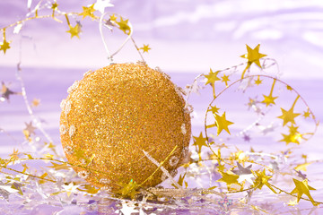 holiday series: christmas golden ball with star-shaped garland