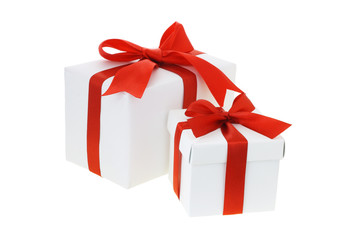 Two gift boxes with red bow ribbons on white background