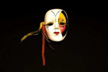 Female carnival mask isolated on black