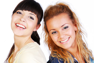 Portrait of two teen girlfriends on white background