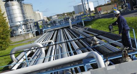 engineer turning on pipelines