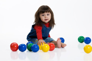 Little Girl Playing With The Coloured balls