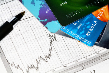 An image of credit cards on stock chart