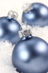 Three ornaments and snow
