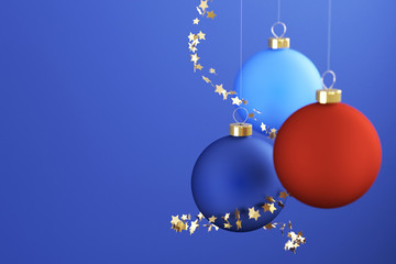 Christmas balls and ornaments over a blue background.