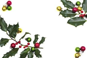 Holly berry with christmas balls isolated on white