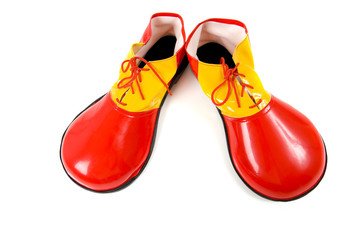A pari of oversized red and yellow clown shoes