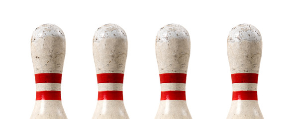 A group of four bowling pins on a white background