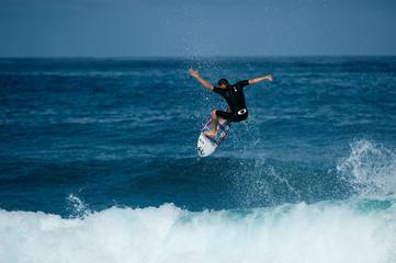 surfer doing big ariel