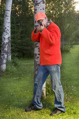 male hunter aiming rifle at his prey
