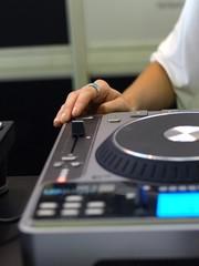Close up of Lady's hand on DJ sound mixer