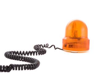 orange siren with wire on the white