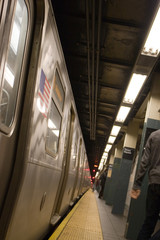 The side of a New York City subway while not in motion.