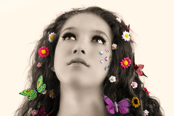 Girl with butterflies and flowers in her hair
