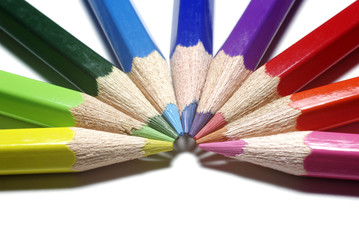 Half-circle of colour pencils isolated on white background.