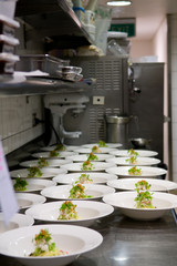 Neat rows of prepared food in a busy restaurant kitchen