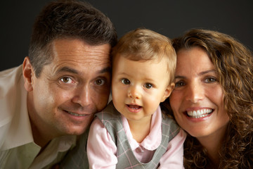 portrait series of happy young family