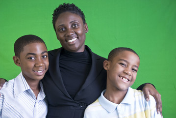 A young African American mother and her two young boys.