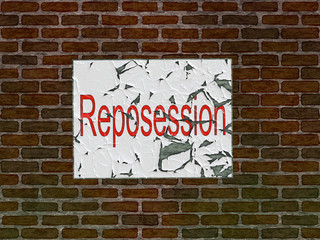 Brick wall of home with faded reposession poster
