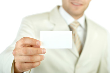 Businessman holding visit card isolated