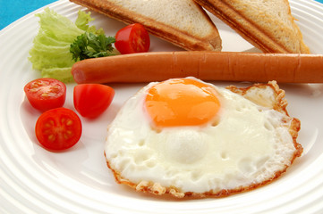 Breakfast - toasts, egg, sausage and vegetables