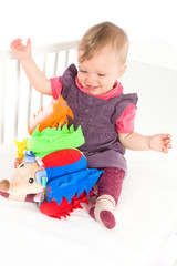Baby playing with soft toy