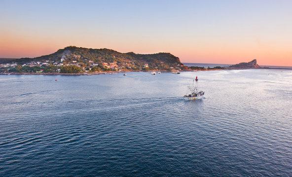 Fishing Boat in Mazatlan Heading out to Sea