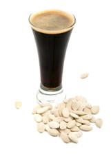The glass of dark beer and pumpkin seeds