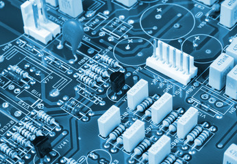 blue circuit board with components