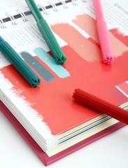 felt pens on the book