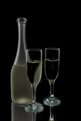 Pair of wine flutes and bottle