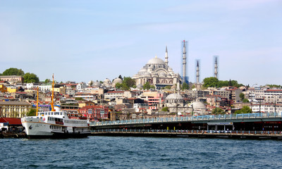 Mosque, bridge and a boat from historical Istanbul